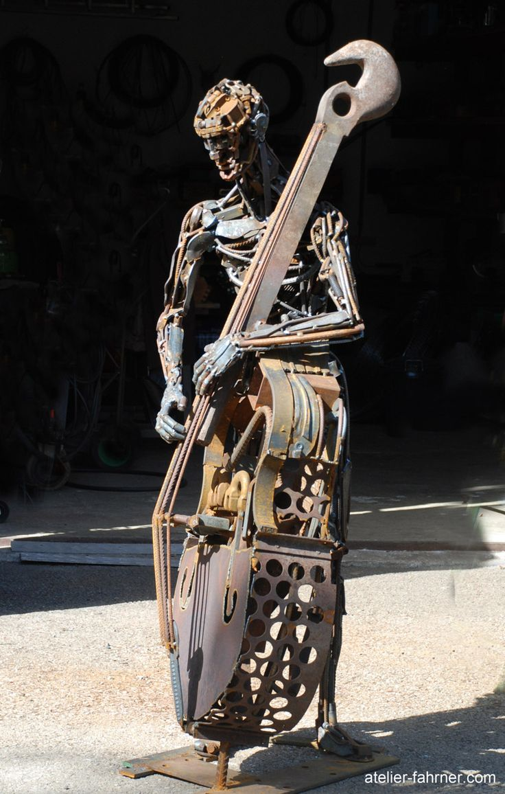 double bass and musician made of recycled metal its all. Black Bedroom Furniture Sets. Home Design Ideas