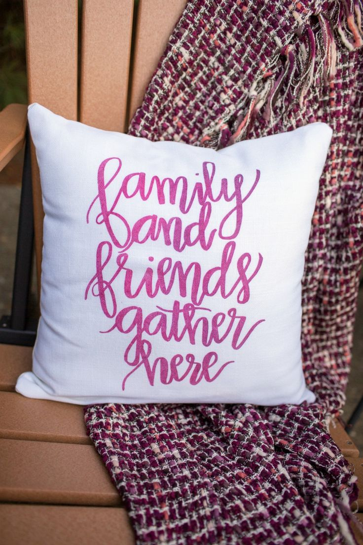 "Custom pillow via @tiny_prints for Friendsgiving dinner party. ""Friends and family gather here""."