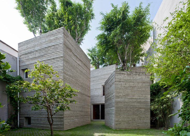 Trees grow on top of five concrete boxes, like oversized pot plants, at this house in Ho Chi Minh City.