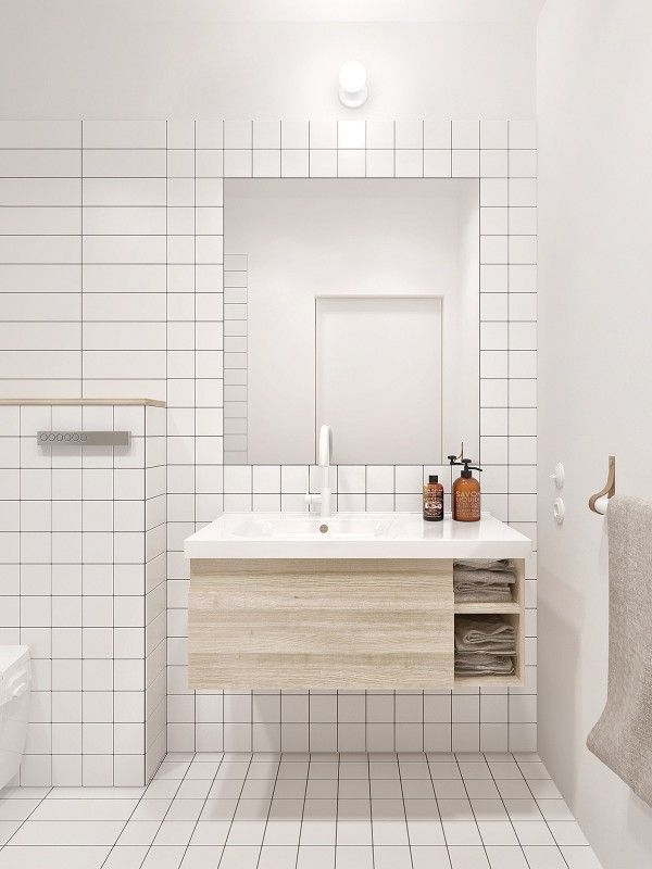 The bathroom is perhaps the only space when a bit of luxury seems to creep in. The white tiled walls and floors are not particularly luxe, but the have a feeling of something indulgent from their smooth texture to their ultimate simplicity. The sink basin and small storage area make organization essential.