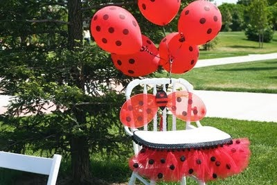 Ladybug balloons.....what a cute idea. Red balloons with black dots painted on them.