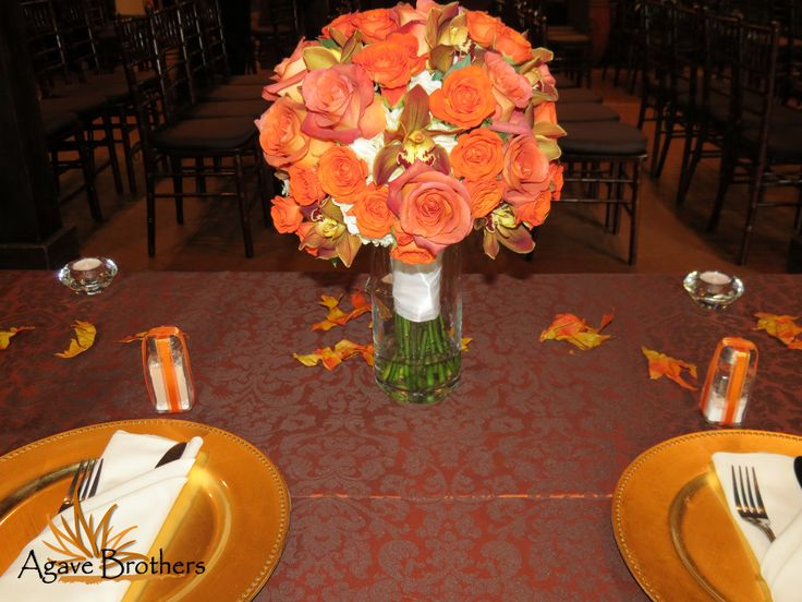 So beyond obsessed with this tablescape and how AWESOME this bouquet looks as the centerpiece! Deep orange and rust Roses, Snapdragons and just a little hint of white hydrangea showing through.  Love. #agavebrothers #fall #wedding #flowers #bouquet