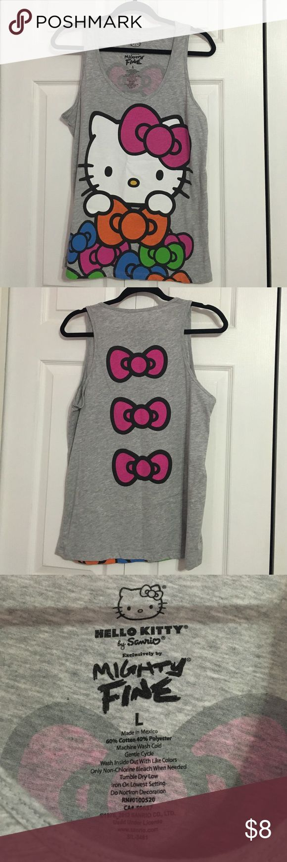 Hello Kitty Bow Tank Top Super cute Hello Kitty bow tank top! Has adorable bow details on back. Worn a few times. Mighty Fine Tops Tank Tops