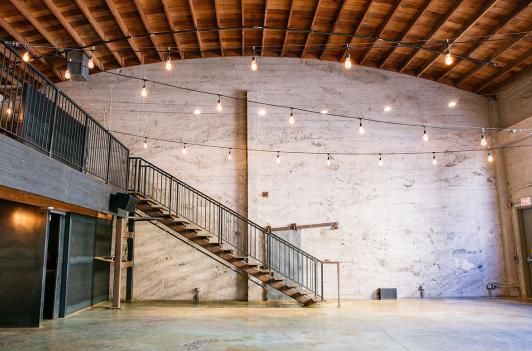 With massive windows, soaring ceiling heights, cement floors, and tons and tons of exposed brick, these party spots are industrial gold.