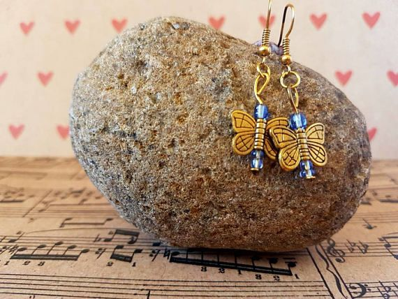 Check out this item in my Etsy shop https://www.etsy.com/au/listing/540210067/butterfly-earrings-gold-and-blue