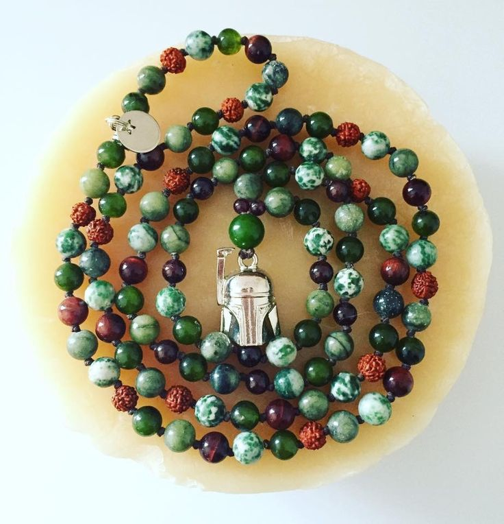 "108 bead Boba Fett Mala with Red Tiger Eye, Garnet, Tree Agate, Rudraksha, Serpentine and Olive Green Agate 6 and 8mm beads.  Hangs at about 21"" $90 plus shipping  #BobaFett #StarWars #BountyHunter #Mala #Necklace #Jewellery #Jewelry #Stones #Healing #Gemstones #TigerEye #Rudraksha #Agate #Serpentine #Garnet #TreeAgate #108beads #Mantra #Meditation #Yogi #Boho #CanadianDesigner #JediJewellery"