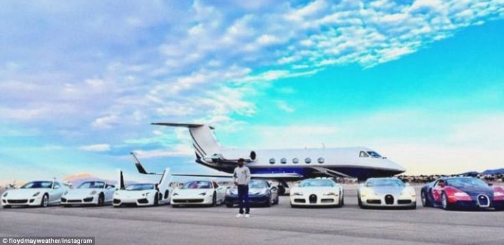 Boxer Floyd Mayweather was again up to his old tricks by flaunting his wealth - posing in ...
