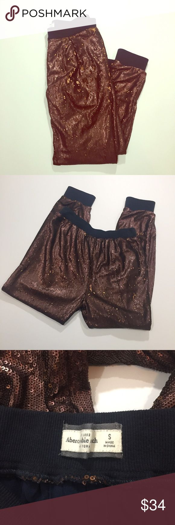 """A&F // Full Sequin Shine Copper Brown Jogger Pants Like new condition! Be the life of the party in these full sequin, jogger-style pants from Abercrombie & Fitch. Pull on style with rubbed waistband and ankle cuffs. Machine washable. About 26"""" inseam, 12"""" rise, 14.5"""" across waistband. 🚫trades🚫 smoke free home Abercrombie & Fitch Pants Track Pants & Joggers"""