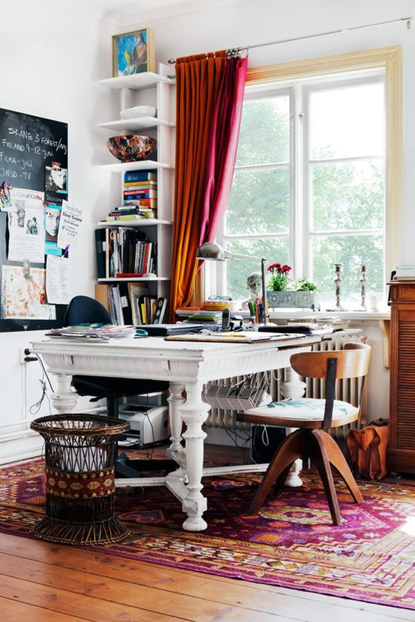 Like how the desk sits perpendicularly to the window, and the tall shelf tucked in the back. Don't like the table, but really like the chair.