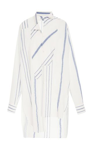 Loewe's tunic can be worn as an oversized top or coverup for days by the beach. Cut from airy cotton, it's designed with an asymmetric hem as well as stripes.