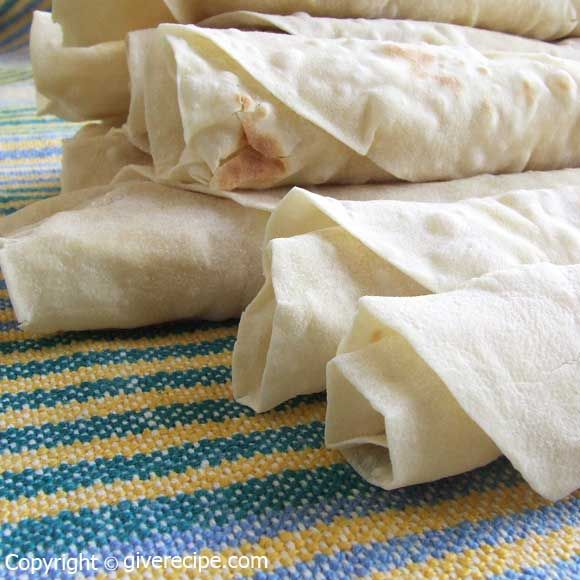 Homemade flat bread. Stuff it with feta, roll it up and make sandwiches this way. | giverecipe.com | #bread