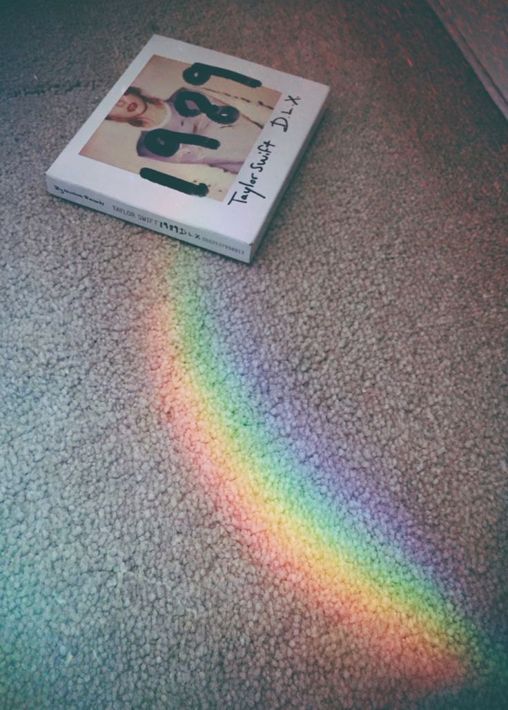 CD of gold at the end of the rainbow near wonderland...yeah, that just happened. OMG Please visit our website @ https://22taylorswift.com