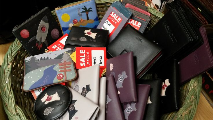 No, your eyes are not deceiving you. Yes, that is a whole basket of Radley goodies, including Radley purses, Radley wallets and Radley accessories, many featuring Radley's lovely picture designs or the iconic Radley scottie dog logo - and they're reduced! Pop into store to see our full range...
