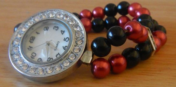 Large round ladies watch with red and black band