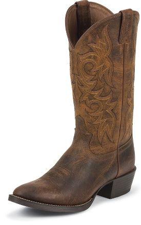 Justin Boots Mens Rugged Tan Cow Boot Los bootas vaquero de cuero de justin es muy durable.  Cuesta trescientos dalores.  A mi me gusto los bootas porque hay es muy arnable y comodo.