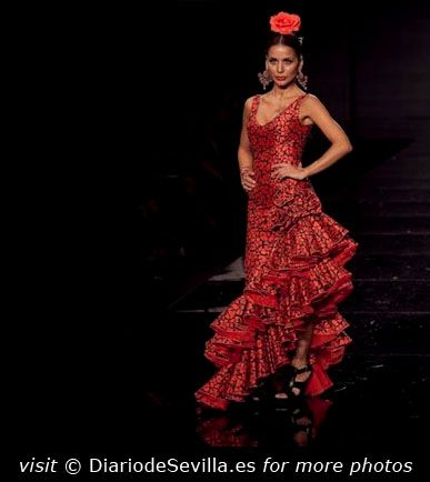 Mª Carmen Cruz creation in classic red  at the 2010 Flamenco Fashion Show in Seville.
