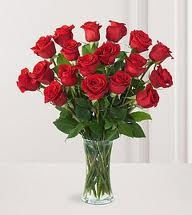 18 Beautiful Red roses in a Glass vase to India