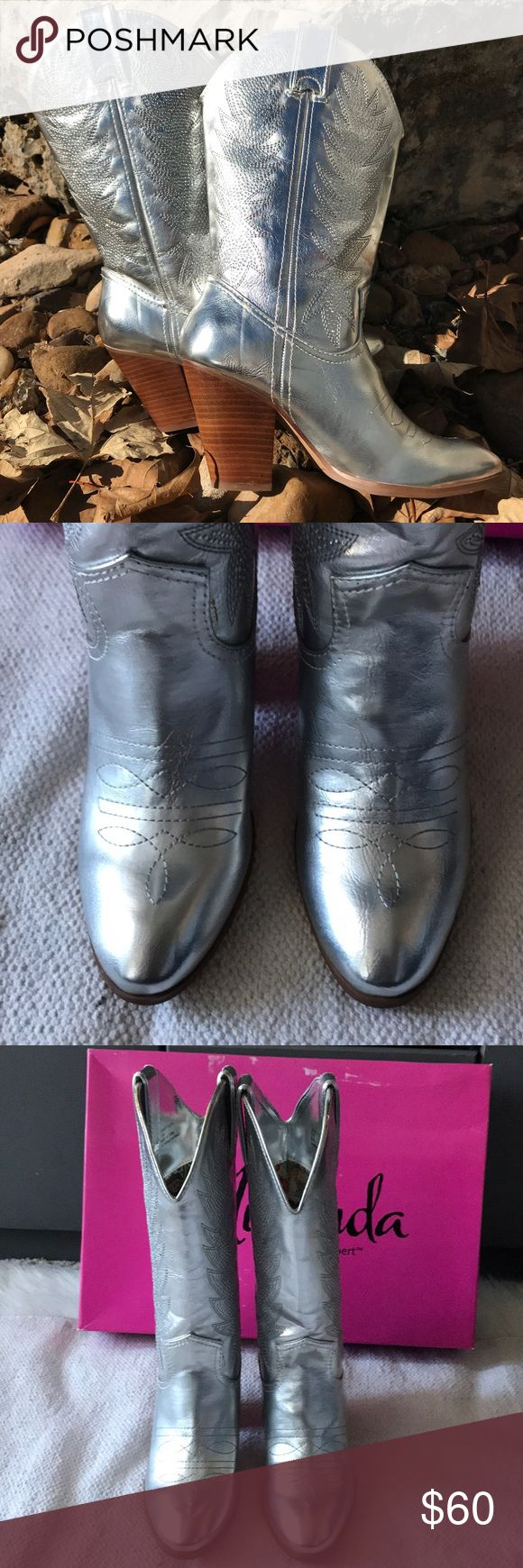 Miranda Lambert Silver Sparkle COWBOY Boots These boots are new with box, never been worn. They are absolutely gorgeous silver metallic with white rhinestone studs all the way up both sides. They are a 7 1/2 but have a room and can fit up to an eight with a thin sock. Heel is 3 1/2 inches high. Shaft height is 10 1/2 inches, Opening is 15 inches around. I have big calves and I can fit them fine. Miranda Lambert Shoes Heeled Boots