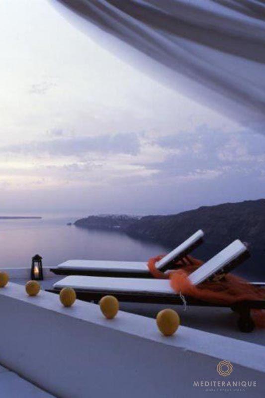 Volcano views at dusk from Rocabella Santorini http://www.mediteranique.com/hotels-greece/santorini/rocabella-santorini/