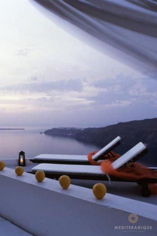 Volcano views at dusk from Rocabella Santorini http://www.mediteranique.com/hotels-greece/santorini/rocabella-santorini/