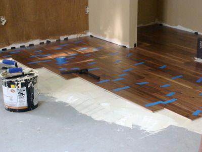 Installing hard wood floor over concrete