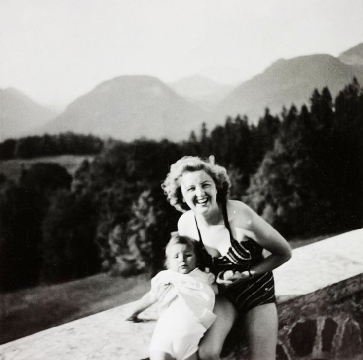 Eva Braun on the Berghof terrace with the daughter of Herta Schneider, her closest friend.