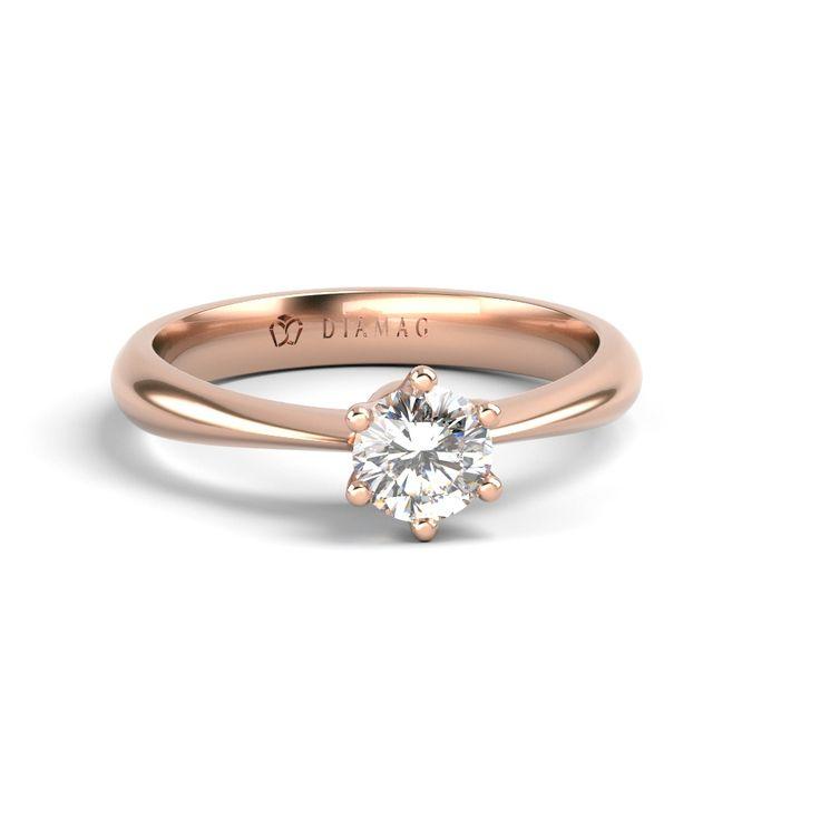 Șina acestui inel de logodna solitar din aur roz se îngustează treptat înspre…
