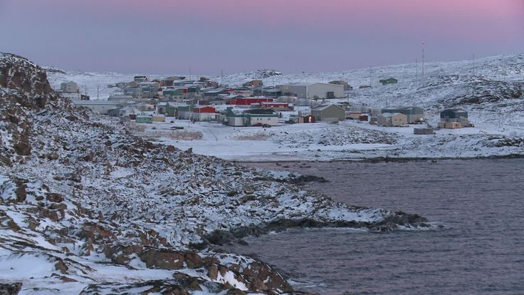 "Quaqtaq, meaning ""tapeworm"". The village of Quaqtaq is located on the eastern shore of Diana Bay, called Tuvaaluk (the large ice field) in Inuktitut, on a peninsula which protrudes into the Hudson Strait where it meets Ungava Bay. Mountains stand on the peninsula to the north and to the south-east are short, rocky hills. The region around Diana Bay is rich with land and sea mammals, as well as fish and seafood, including mussels, scallops and clams. Population: 315"