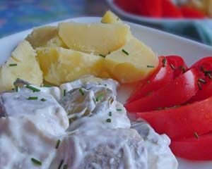 Try this traditional German herring salad http://www.quick-german-recipes.com/herring-salad-recipe.html -- Kids just love the creamy, sweet taste!