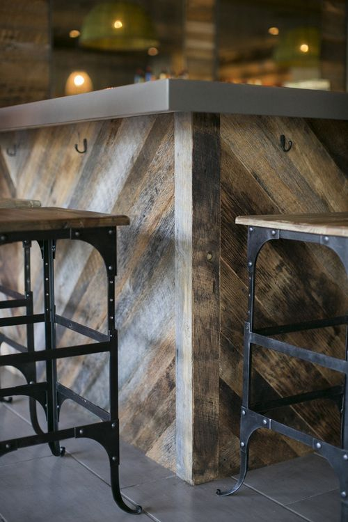 Rustic, reclaimed-style wooden bar with modern steel accents and rustic metal and wooden bar stools inside Columbia, S.C. Italian restaurant Pasta Fresca. Full-scale commercial interior design by MACK Home.
