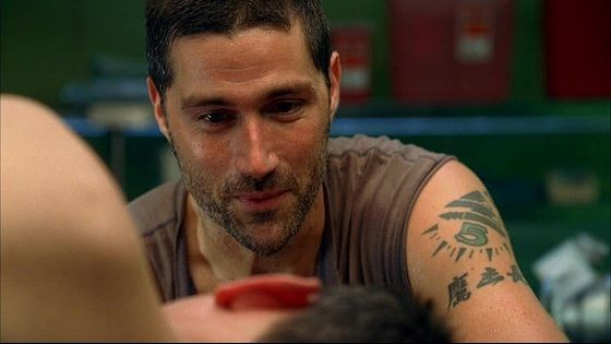 2 Jack (Matthew Fox) is an American surgeon who after the plane crash becomes sort of a leader to the rest of the survivors. He provides guidance and unites people, helping them build a community. He has three tattoos: on his left shoulder, left elbow, and left forearm.