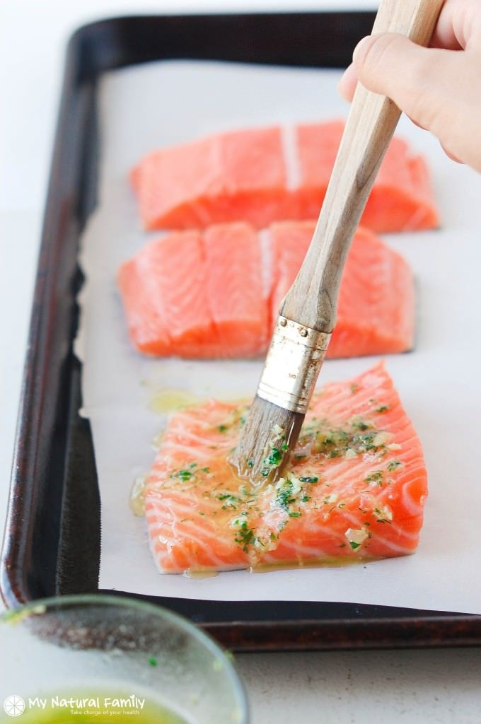 This Lemon Garlic Herb Crusted Salmon recipe is quick and easy! Placing the salmon fillets on a Parchment Paper-lined baking sheet will cause the fish to turn out light and flaky and be full of flavor!