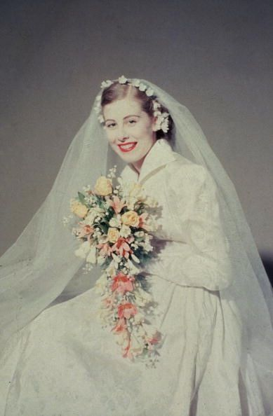 Bride, circa 1950s. Love the lace collar and gorgeous bouquet. Stylish and etheral.
