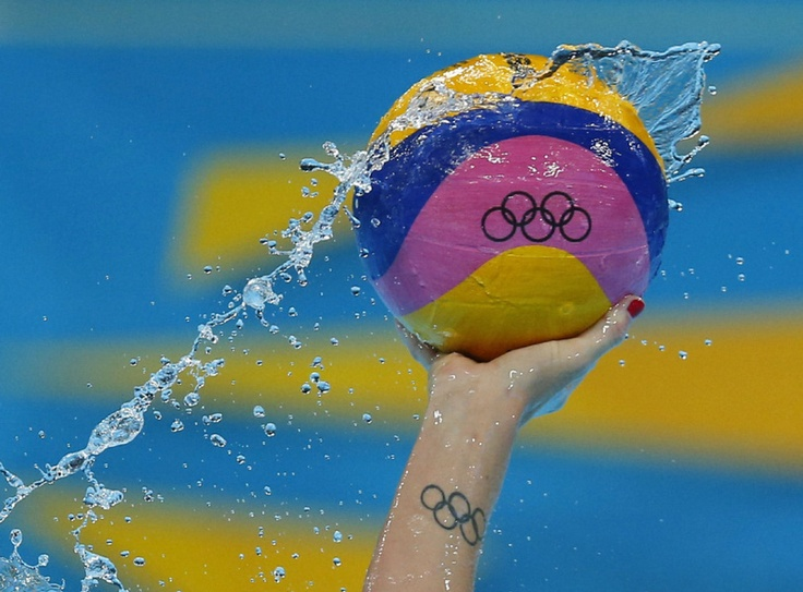 Gabriella's Szucs from the U.S controls the ball during their women's preliminary round Group A water polo match against Hungary.