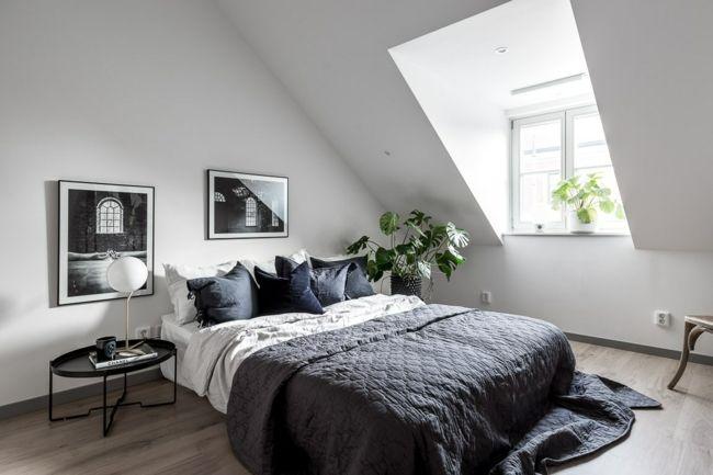Schlafzimmer auf dem Dachboden  ideale Ruhezone  grüne Zimmerpflanzen  erfrischen das Interieur