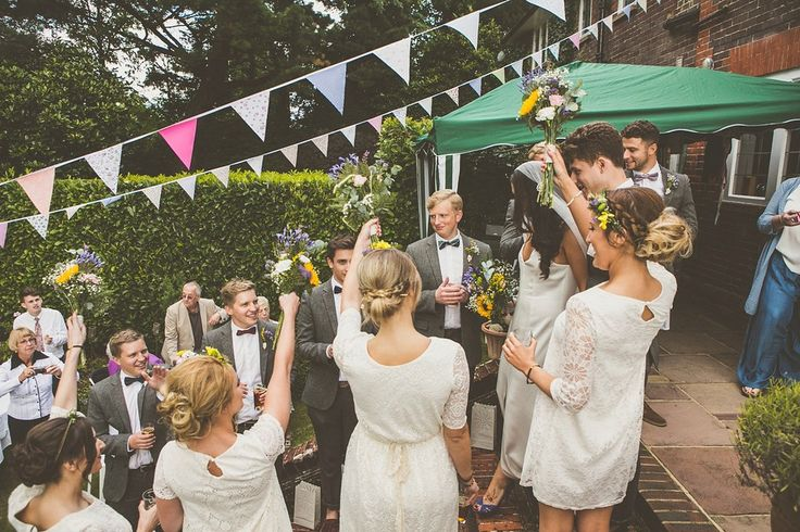 Kat wore an Oxfam wedding dress for her laid back and homemade wedding in her Mum's back garden.
