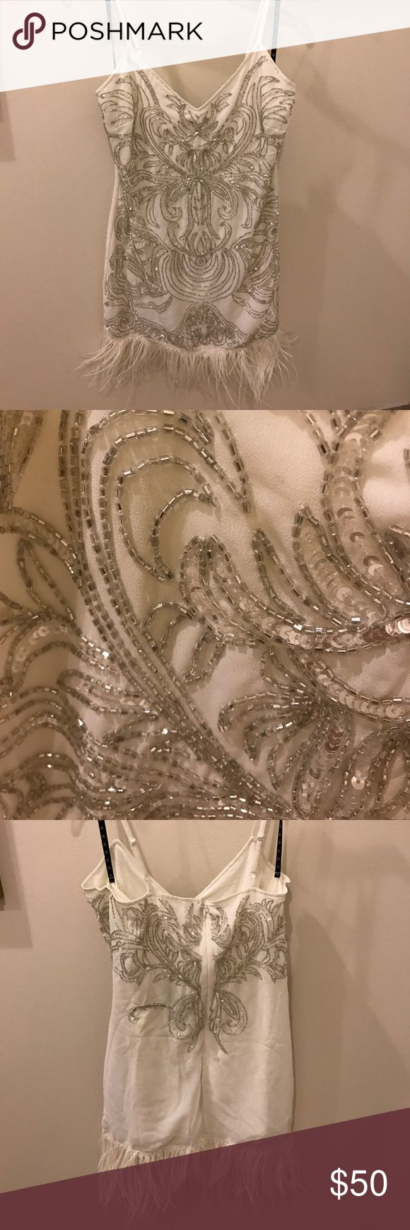 MISSGUIDED white beaded dress with fur trim white dress, silver beading, white fur trim. has adjustable straps. NWT!!!!! Missguided Dresses Mini