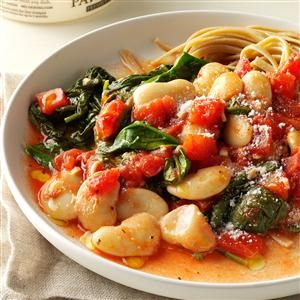 Tomato & Garlic Butter Bean Dinner Recipe -For those days when I get home late and just want a warm meal, I stir up tomatoes, garlic and butter beans. Ladle it over noodles if you're in the mood for pasta. —Jessica Meyers, Austin, Texas