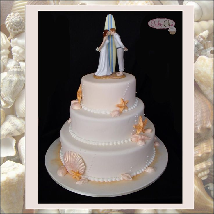 Beach Wedding Cake with shells and surf board cake topper.