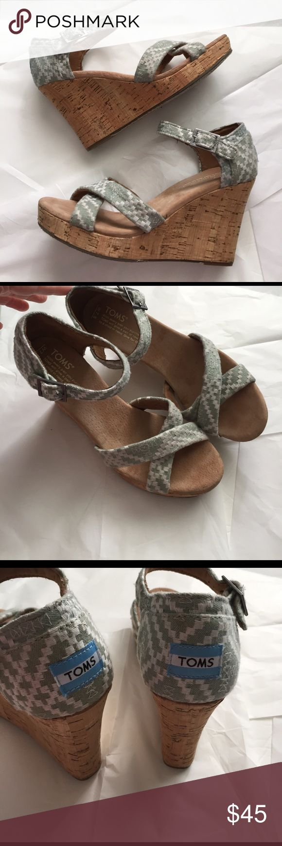 TOMS Wedge Sandals! TOMS wedge Sandals! Cork wedge with aztec print straps! Gray/green color! 4 inch wedge! Great condition! Gently used! TOMS Shoes Sandals