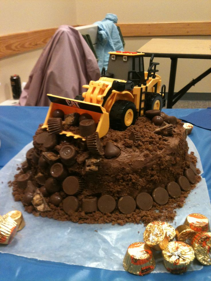 Tonka truck cake for my little cousin. He's the cutest and I think this cake throws him together all in a nut shell lol