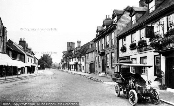 The east end of the High Street, looking east. Ye Dorset Arms, once the town's principal coaching inn, had many changes of proprietor at this time, and its brickwork had already suffered the indignity of white paint. The handsome Dorset House next door is dated 1705. The motor car has one of the earliest registration plates (London, 1904) and may have been one of the first seen in East Grinstead.  East Grinstead, High Street 1904, from Francis Frith.  #francisfrith #nostalgia #vintagecars