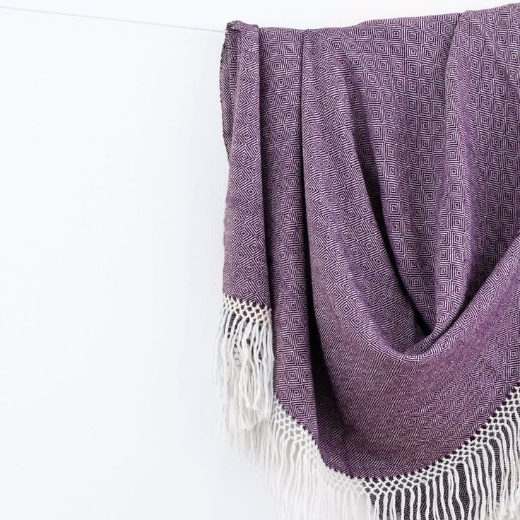 Beautifully handwoven in a fair trade environment, this deep purple blanket is made with 100% baby alpaca fibers.