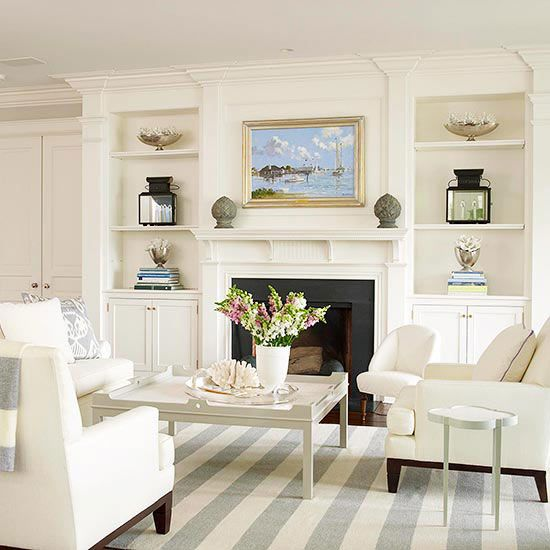Paired with built-in storage units, this fireplace becomes a natural anchor point for the living room's furniture arrangement, thanks to its substantial expanse: http://www.bhg.com/decorating/fireplace/styles/fireplace-designs/?socsrc=bhgpin031614fireplacewall&page=5
