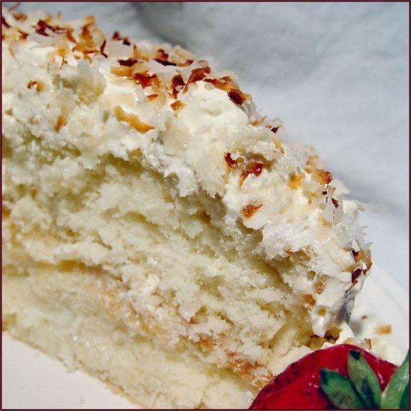 Coconut Sour Cream Cake A Simple White Cake With A Sour Cream Coconut Frosting A Light Refresh Sour Cream Coconut Cake Sour Cream Cake Coconut Cake Recipe