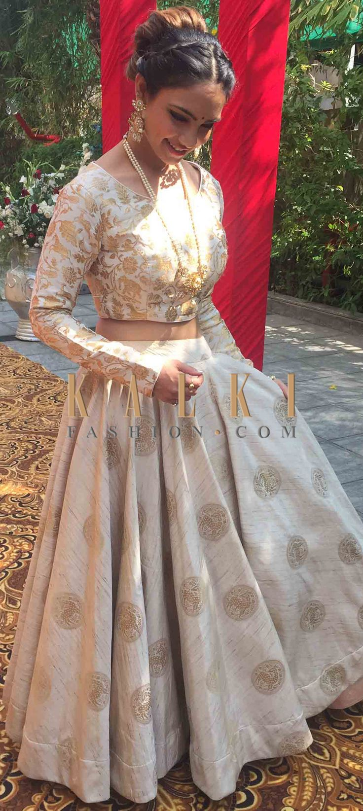 Buy Online from the link below. We ship worldwide (Free Shipping over US$100)  Click Anywhere to Tag Pooja Banerjee in Kalki beige brocade lehenga featuring the beautiful animal motifs f you are not the one with reds and pinks, go for the beige lehenga that is high on its fashion quotient.  The lehenga is featured in brocade.  It showcases deer motif prints that are so easy on the eyes and look absolutely stunning at the same time.  The lehenga comes with a ready stitched blouse in full…