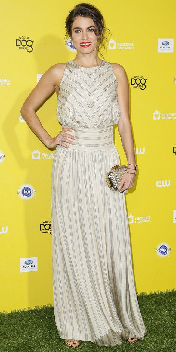 Nikki Reed wore a The Great striped maxi dress and bold red lipstick on the red carpet