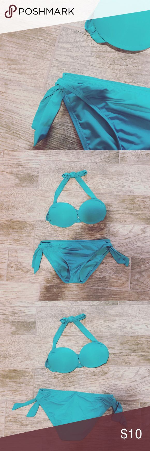 Mossimo Padded Teal Bikini Used in perfect condition!  -Ties at the neck -Extra padding for lift -Shell: 90% Nylon 10% Spandex -Lining is 100% Polyester -Top and bottom are both small petite  ⚜️NO TRADES ⚜️OFFERS WELCOMED! ⚜️BUNDLE TO SAVE ⚜️FEEL FREE TO ASK ANY QUESTIONS! Mossimo Swim Bikinis
