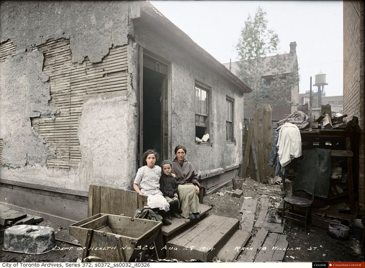 A family in a Toronto slum in 1914 (33 Colourized Photos That Make Canadian History Come To Life)
