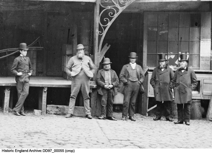 DD97/00055 (Crop) Men in the courtyard of the Talbot Inn, Southwark.   Date: 1870 - 1873 Photographer: York and Son.  Please click for more information or to search our collections.
